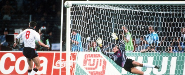 1990 World Cup Semi Final, Turin, Italy, 4th July, 1990, West Germany 1 v England 1 (West Germany win 4-3 on penalties), England's Chris Waddle fires his penalty over the bar past the dive of West German goalkeeper Bodo Illgner in the shoot -out, The penalty miss meant that England were eliminated from the tournament and West Germany reached their third consecutive World Cup Final  (Photo by Bob Thomas/Getty Images)