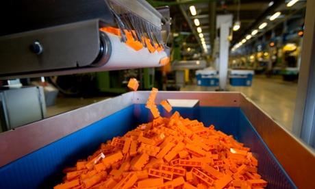 Toy blocks fall into bins at a factory in Billund, Denmark