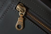 Why do so many zips have the letters YKK on them?